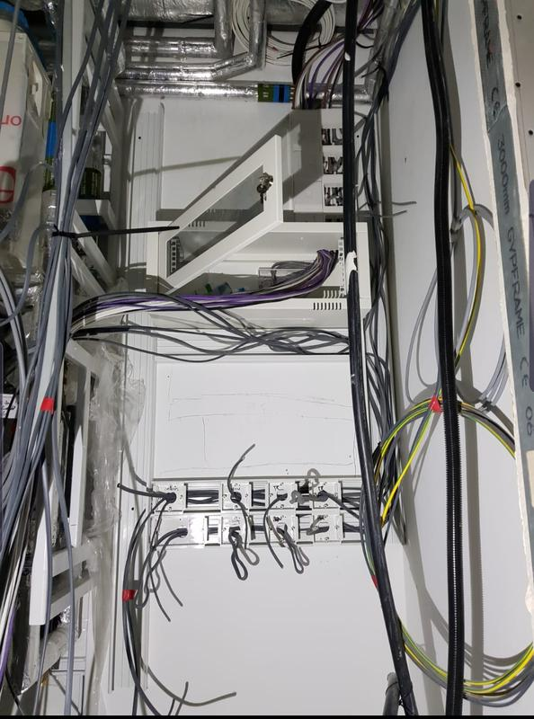 Image 36 - M&E Electrical cupboard being installed with new telephone/cat5e routers. New 18th edition consumer unit with SPD being prepared for installation.