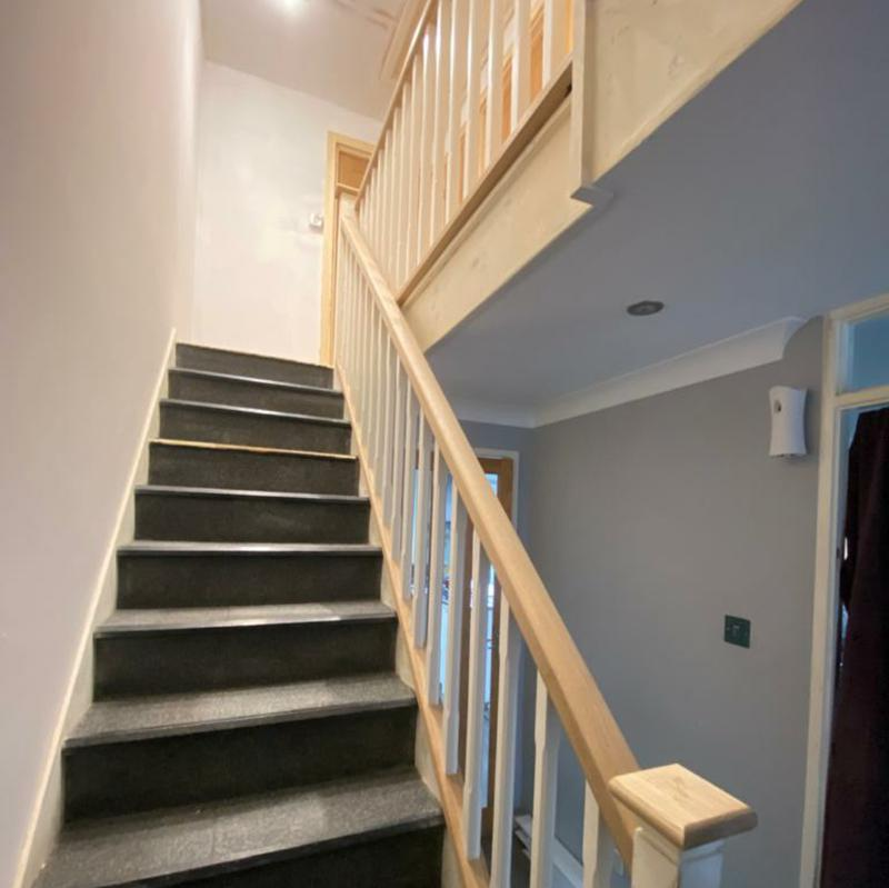 Image 5 - Oak handrail, post caps and new spindles on the staircase.
