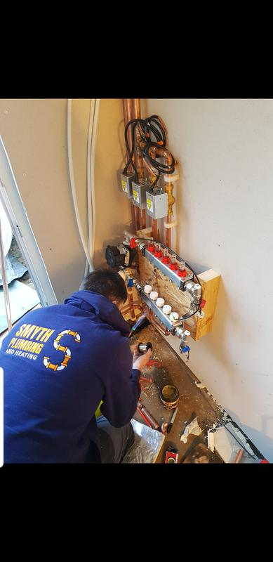 Image 4 - John fitting an underfloor heating manifold