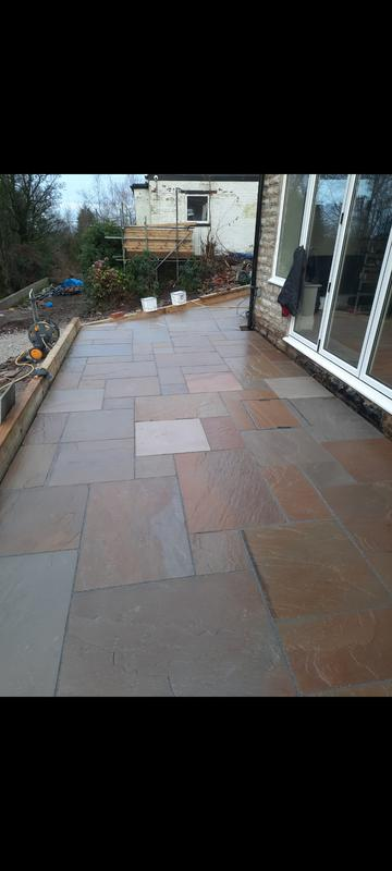 Image 9 - Lots of angles in this patio! We laid 70m² of Raj Indian Stone for a client who had newly renovated an old cottage. Walls that weren't straight and huge differences in levels across the property but we're really happy with the end result.