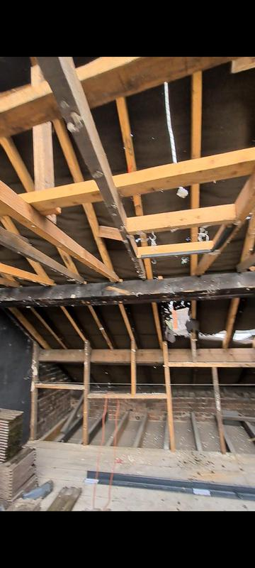 Image 15 - Still stripping the roof.