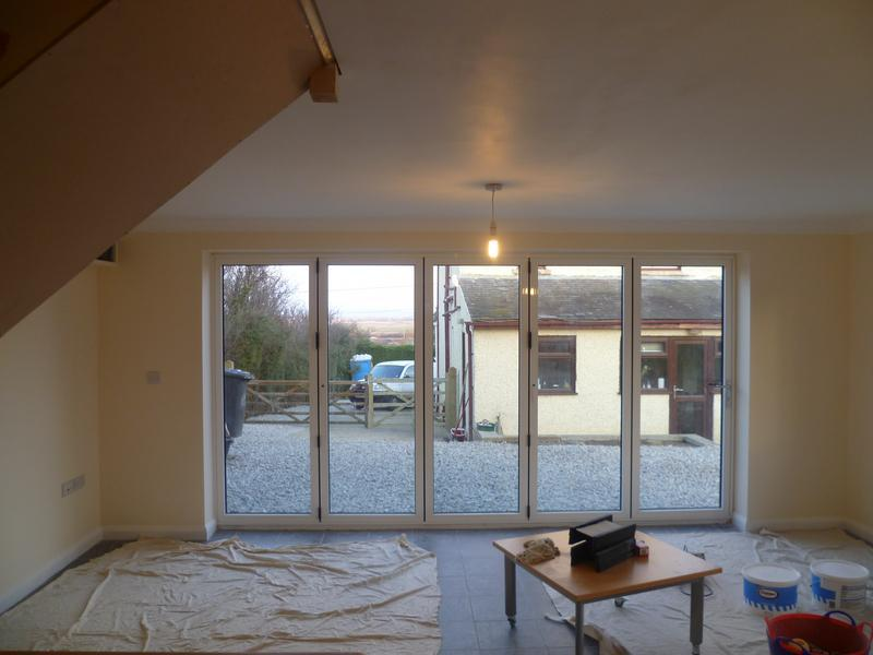 Image 19 - Bi-fold doors create a light and airy garage conversion in Dargate