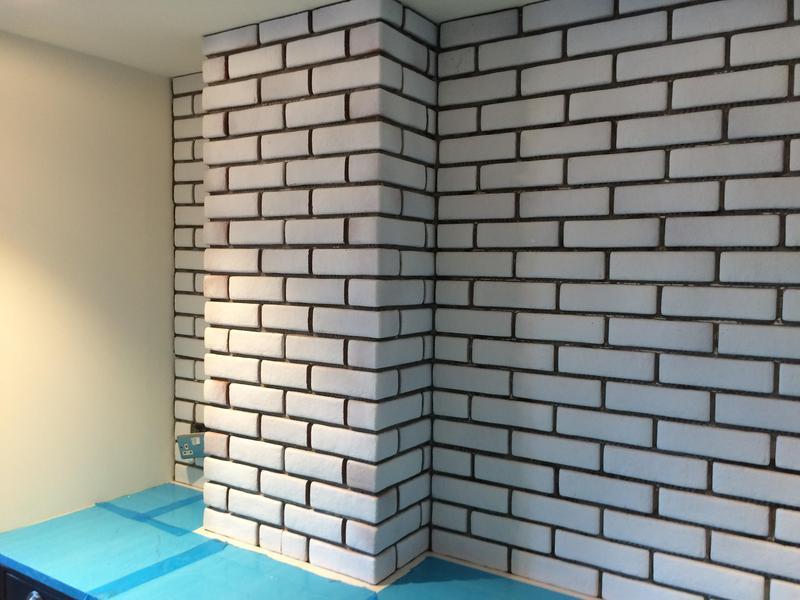 Image 76 - Installing slim flat bricks and corner tiles above kitchen worktop
