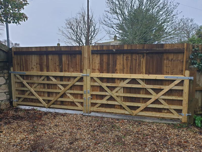 Image 202 - Five bar field gates clad with timber to disguise appearance from outside