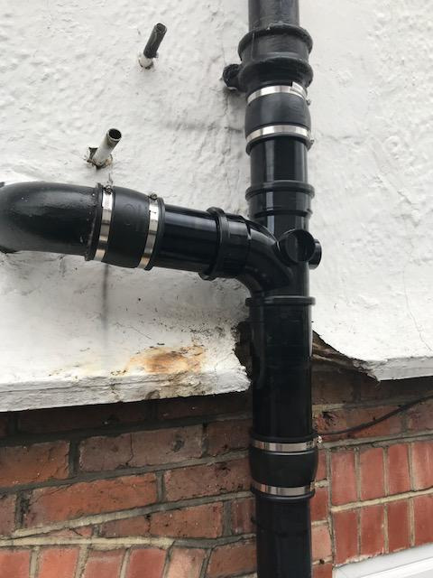 Image 44 - Cast iron soil stack leak, cut out section and replaced with suitable PVC equivalent in Guildford.