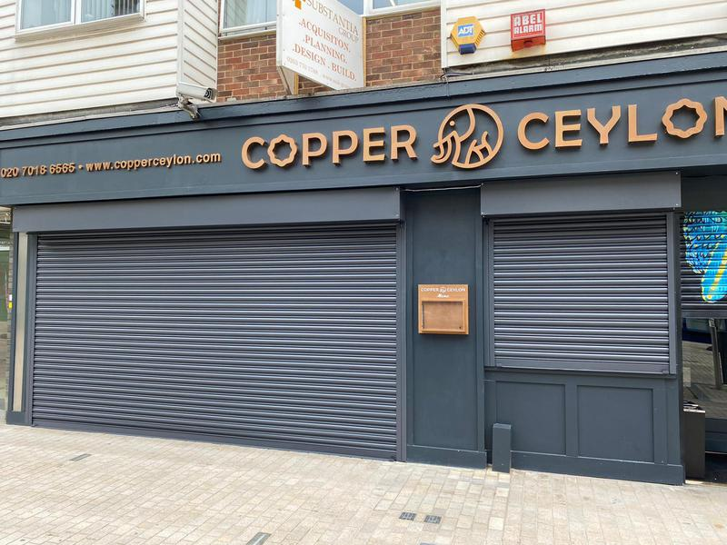 Image 13 - Solid Steel Powder Coated Electric Shutters Installed at                    COPPER CEYLON    BROMLEY BR1