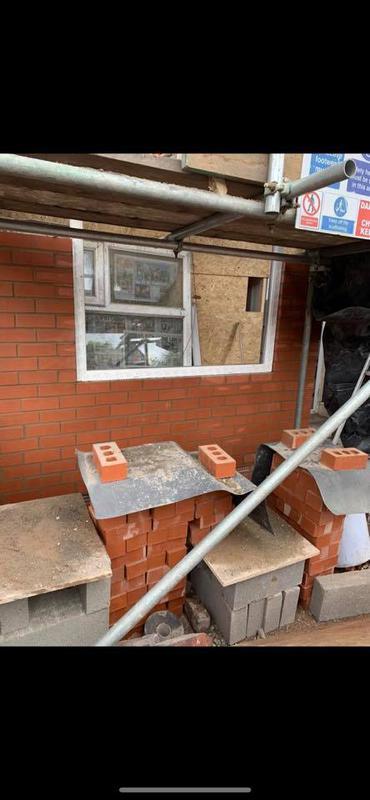 Image 158 - Stockport front rebuilt - During - Fitting windows and brickwork