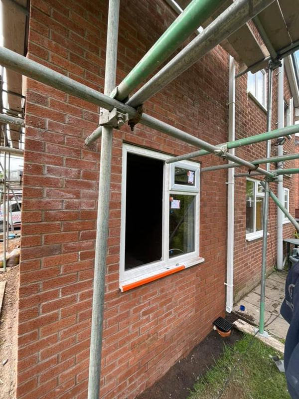 Image 131 - Double story extension - During - brickwork and window placement