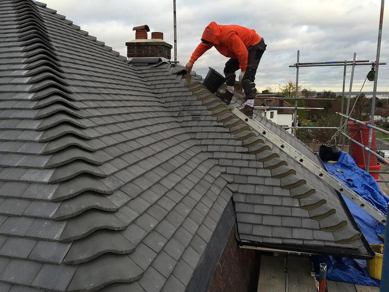 Image 25 - new slate grey plain tile roof  in progress