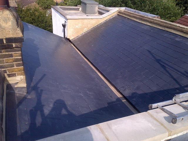 Image 28 - new man made slate roof.