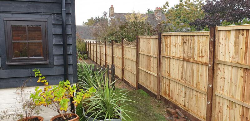 Image 7 - close board panel fencing stepping downwards with trellis