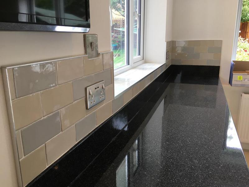 Image 116 - kitchen/utility splash back in a crackle glaze tile