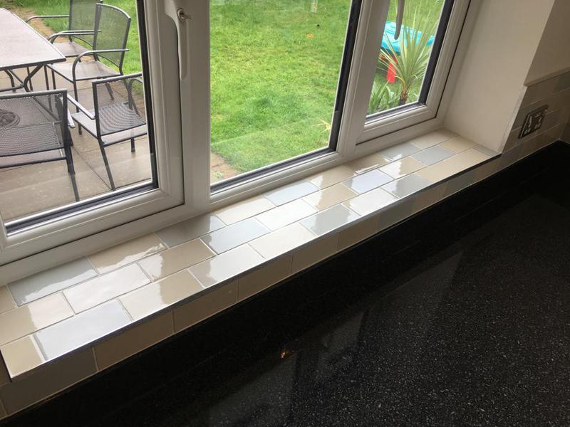 Image 114 - kitchen/utility splash back in a crackle glaze tile