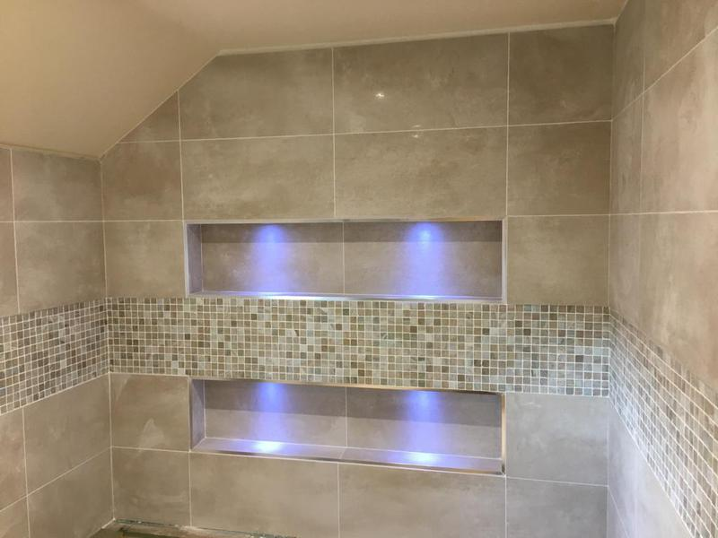 Image 110 - complete bathroom floors and walls - floor levelled - then tiled with a paperface glass mosaic border feature