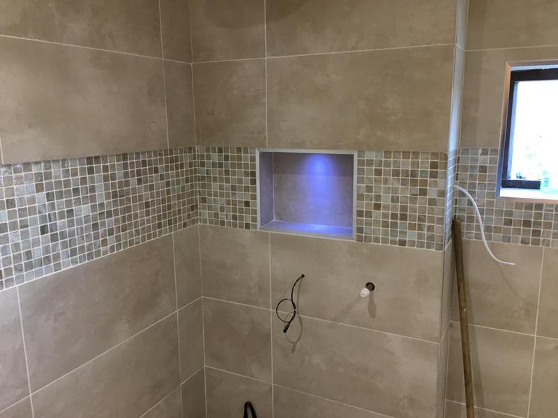 Image 111 - complete bathroom floors and walls - floor levelled - then tiled with a paperface glass mosaic border feature