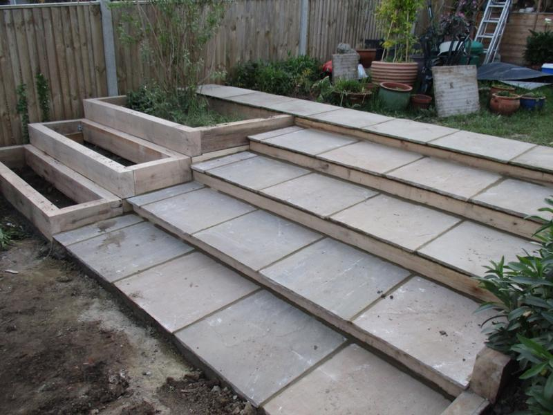Image 25 - Indian sandstone steps and timber sleeper flower boxes.