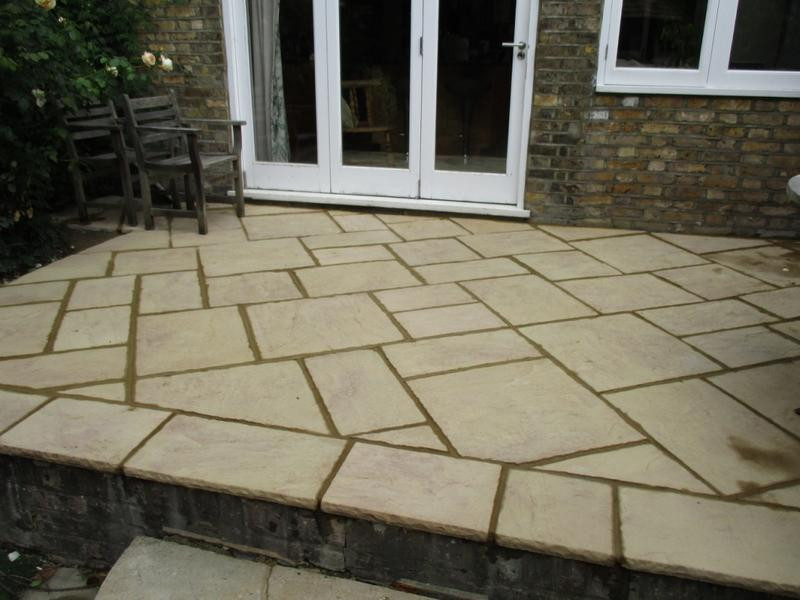 Image 29 - Small caste stone patio with central step.