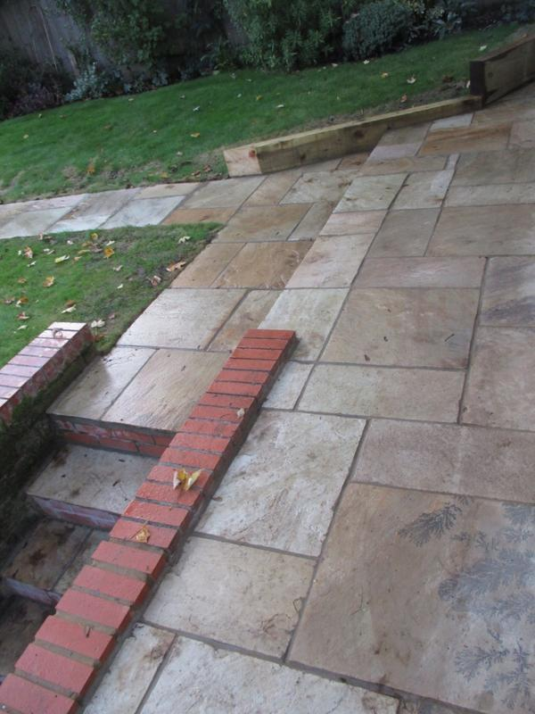 Image 31 - Indian sandstone patio, low sleeper wall, brick wall and steps.