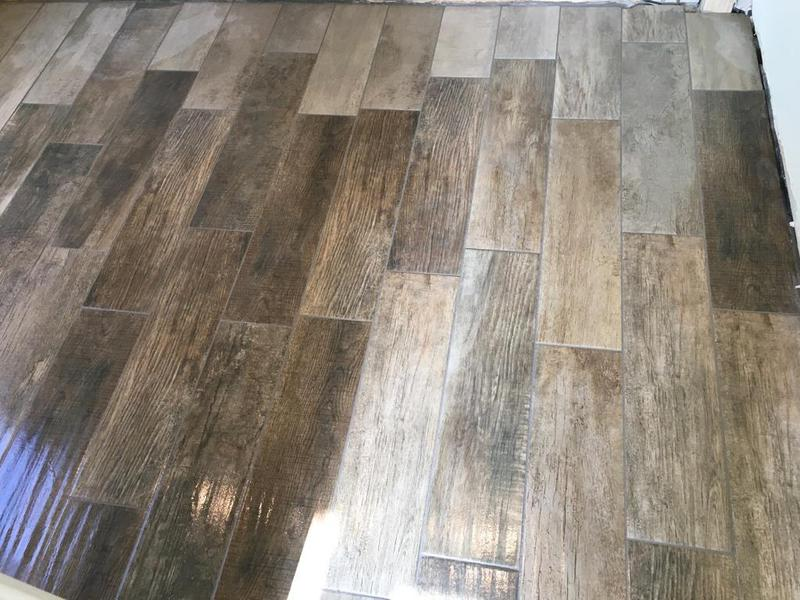 Image 139 - porcelain wood effect tiles installed over underfloor heating - floor levelled beforehand