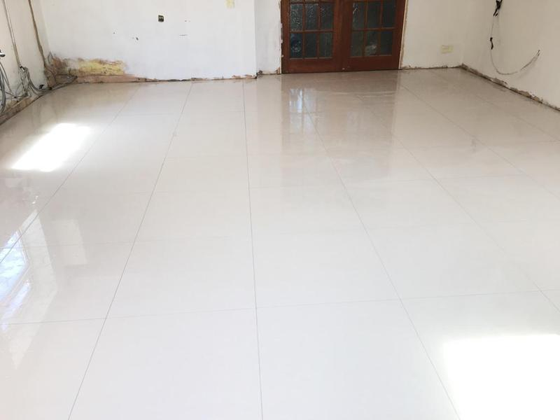 Image 164 - floor levelled then 600 x 600 gloss porcelain tiles installed