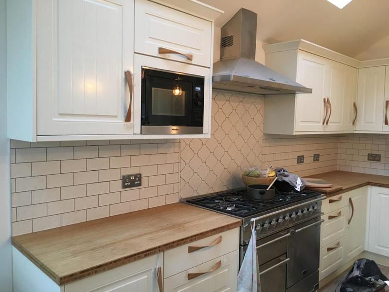 Image 174 - kitchen/utility splash back in a metro tile with a arabesque feature tile