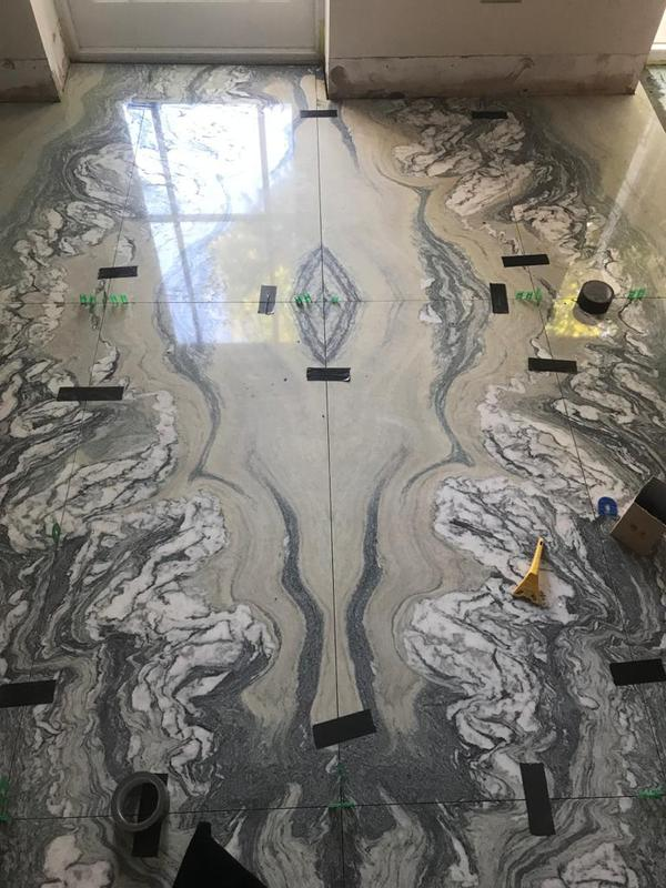 Image 22 - Large sheet marble open fold tiling.