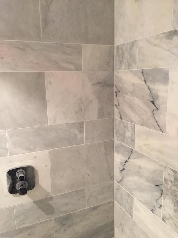 Image 28 - Shower marble tiles.