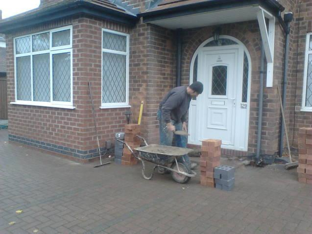 Image 17 - The footings are in and Dave starts the brickwork