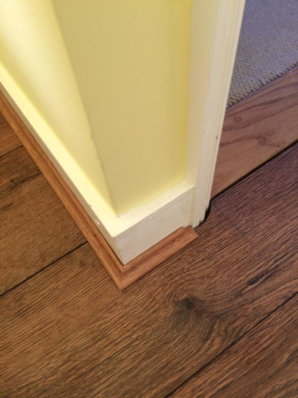 Image 20 - Scotia detail of finish to architrave, laminate floor fitting, by DKM Developments Ltd, builders, Great Dunmow, Essex.