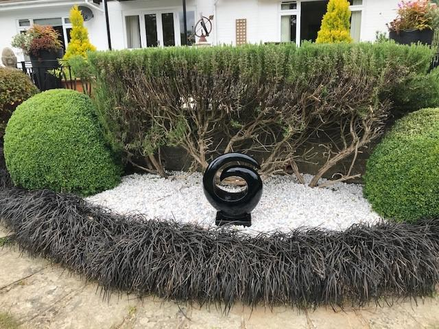 Image 54 - The hand cast ornament we supplied many years ago but renovated again nice & black against new brilliant white base of pebbles,  plus a yearly hand-pruning of the box hedge during June as they should be