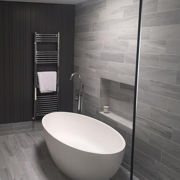 Image 43 - This bathroom has a complete modern feel with its free standing bath tub and wall hung towel rail.