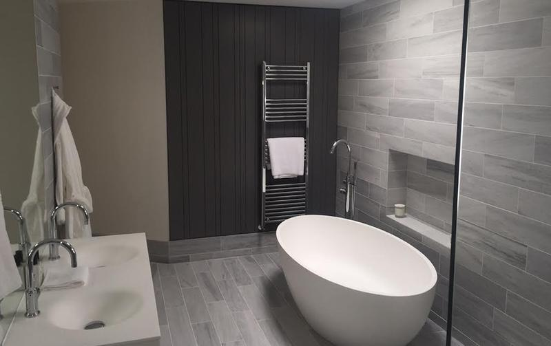 Image 33 - This bathroom has a complete modern feel with its free standing bath tub and wall hung towel rail.
