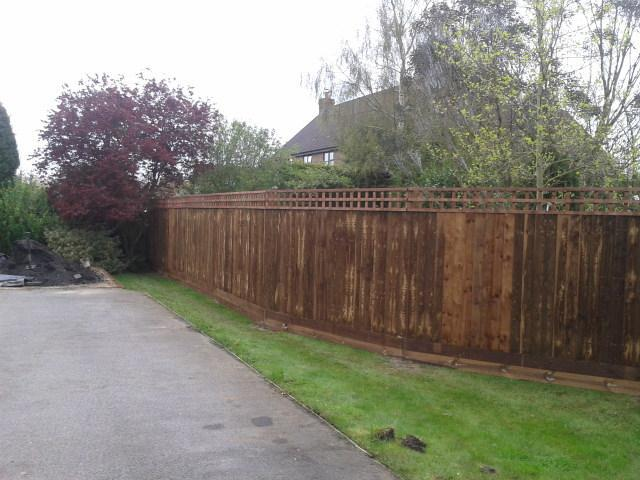 "Image 1 - 5ft 6"" close board fence with trellis on top"