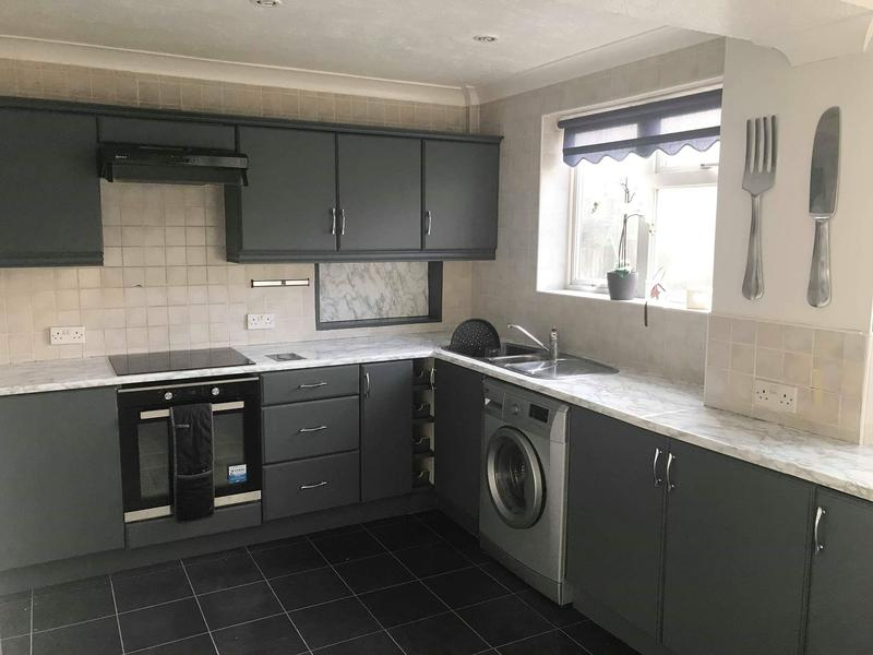 Image 80 - After Kitchen Wrap doors are flattened then modernised with our dark grey matt vinyl and white marble worktop vinyl.