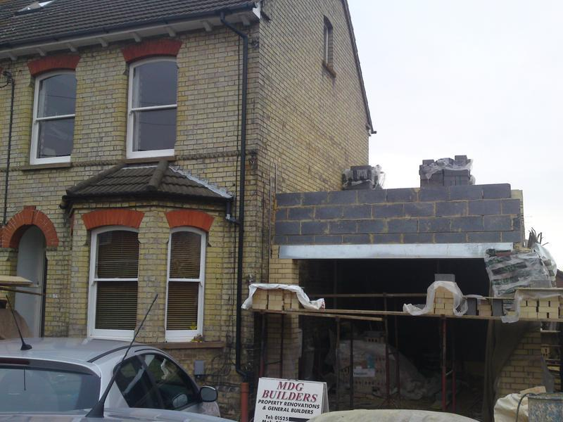 Image 1 - Victorian house side 3 storey extension just after work started.