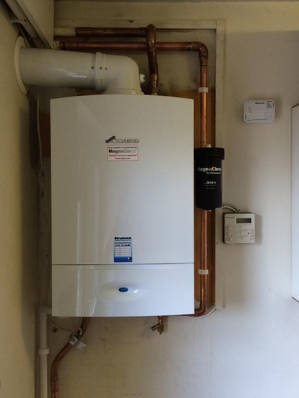 Image 4 - ....New Worcester Bosch boiler fitted, notice the system filter fitted on heating pipe work to give added protection to the boiler from sludge and corrosion deposits.
