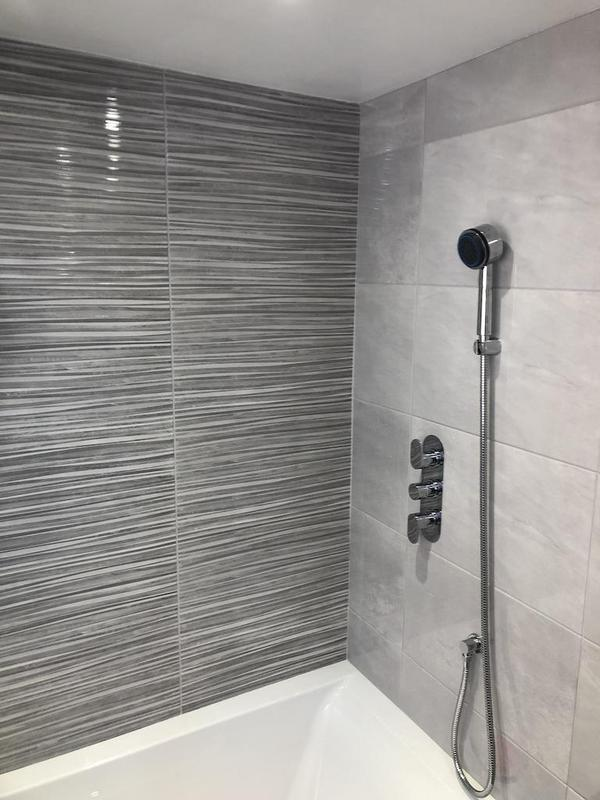 Image 30 - A feature wall in this new bathroom refurbishment. A new shower installed with a bath filler for a classier look.