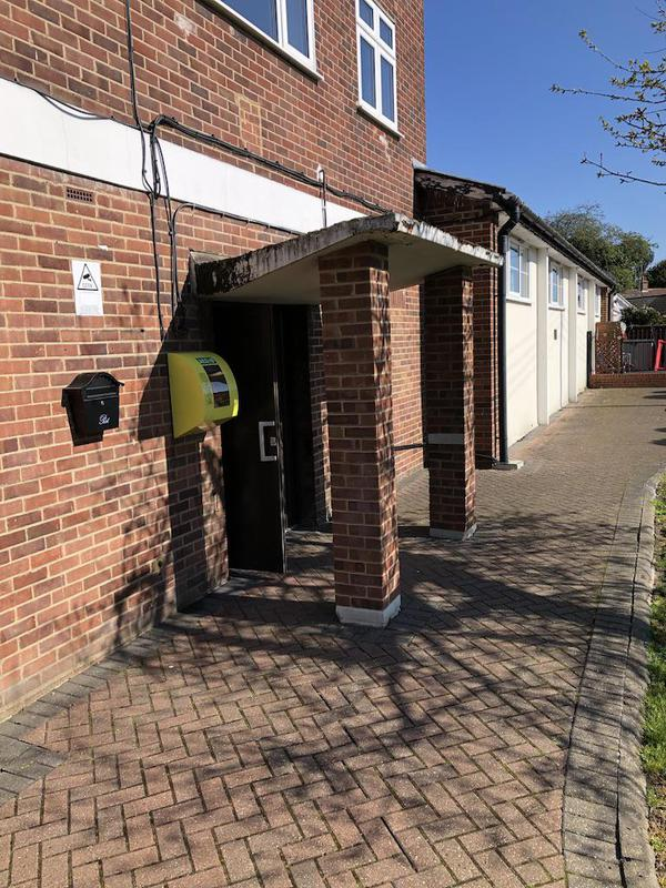 Image 1 - Entrance to village hall was moving, brick piers and concrete canopy removed. A new look coming.