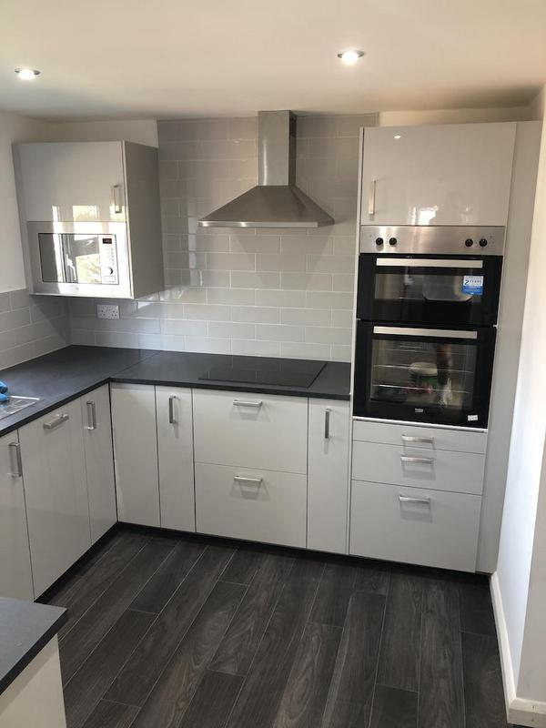Image 14 - A clean fresh kitchen, finished with metro tiles in light grey.