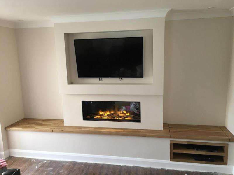 Image 26 - A new wall feature, storage, electric fire and tv surround.