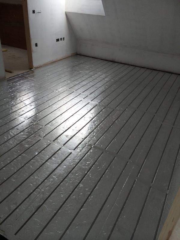 Image 9 - Underfloor heating system being retro fitted, the system being fitted here is an overlay system. Ideal where it is impossible or very costly to dig up existing floors in order to lay a conventional underfloor heating system.