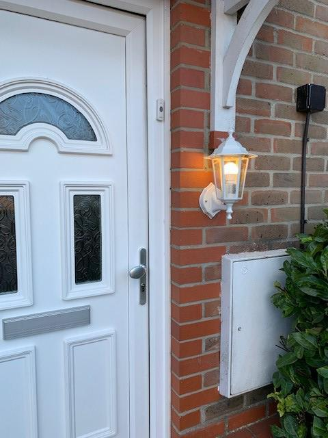 Image 8 - External wall light controlled via switch inside.