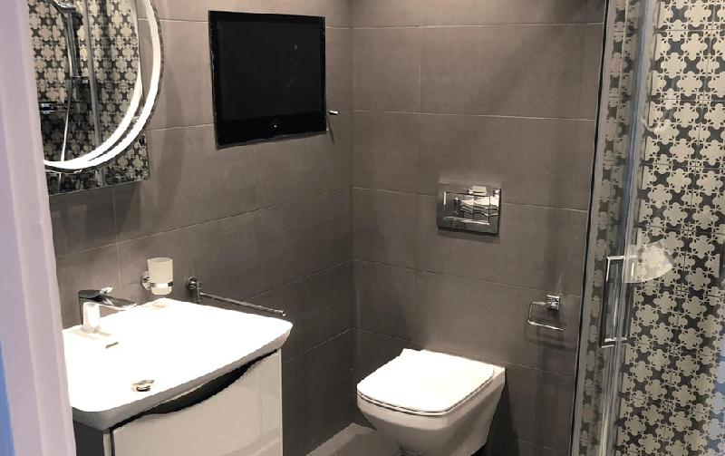 Image 26 - A well presented en suite shower room with an LED mirror and a built in Tv.