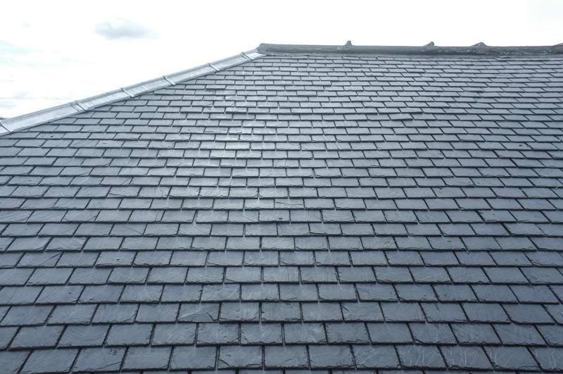 Image 32 - Traditional slate roof .