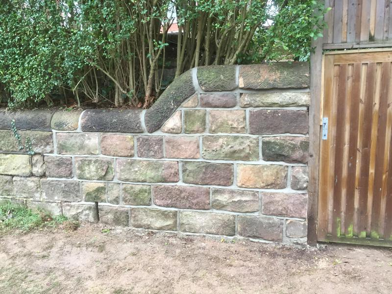 Image 20 - Repaired damaged stone wall.