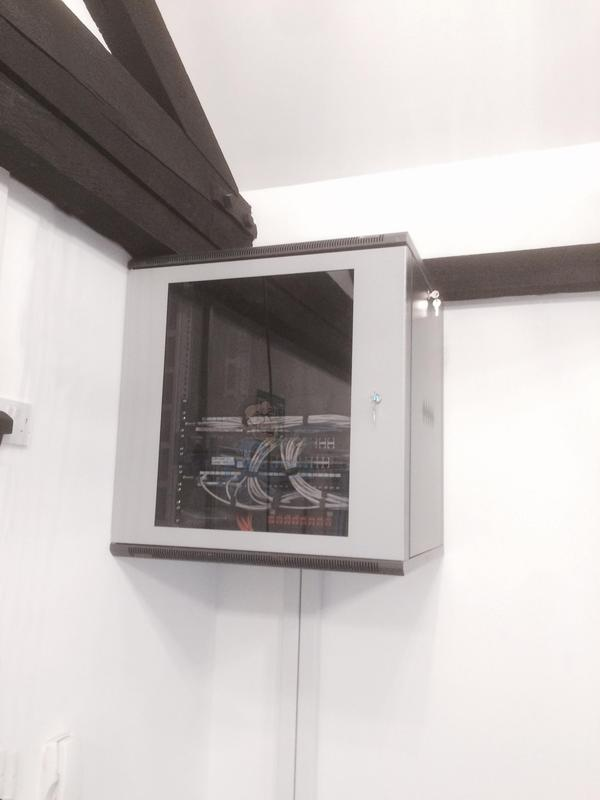 Image 29 - 36 Cat 6a Data points installed in Dado Trunking and terminated into 12 U wall mounted Data cabinet and patched