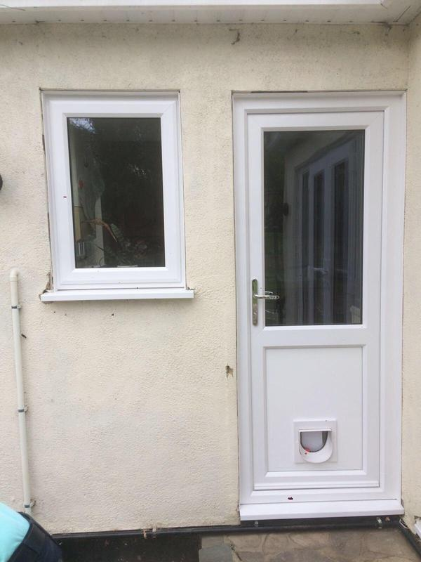 Image 79 - Westcliff-on-Sea-White UPVC panel door with cat flap