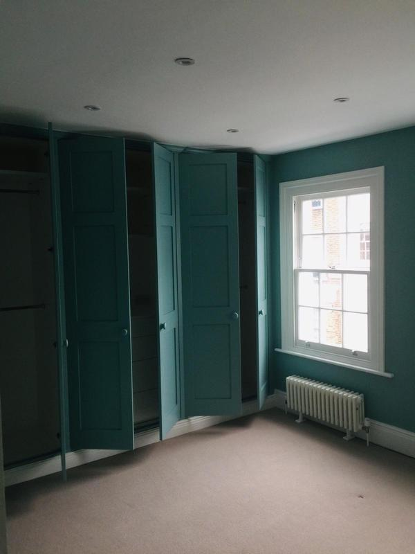 Image 15 - bedroom and repainting of cupboard