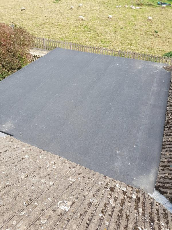 Image 11 - Flat roof installed, both underlay and top felt.