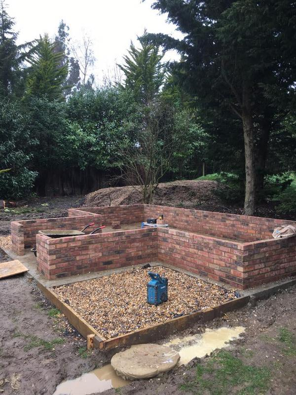 Image 32 - Brick base for a large green house